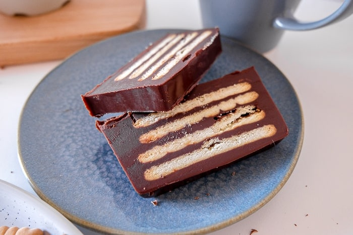 slices of layered cookie chocolate cake on blue plate kalter hund