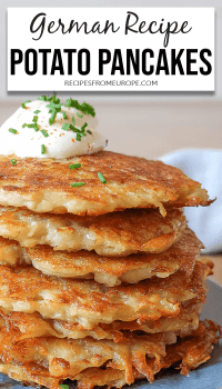 Stack of potato pancakes with sour cream and chives on top