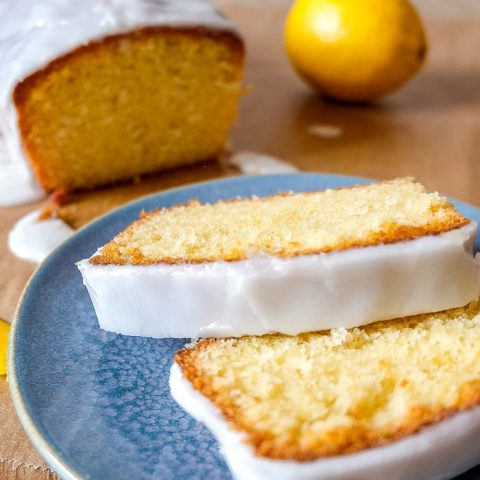 two slices of yellow easy lemon cake with real lemon behind