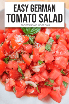 Tomato Salad with basil in bowl and text overlay
