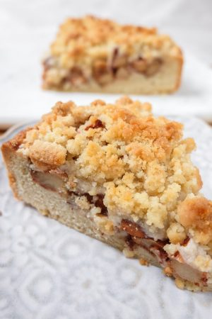german apple cake slices with crumbles on plate