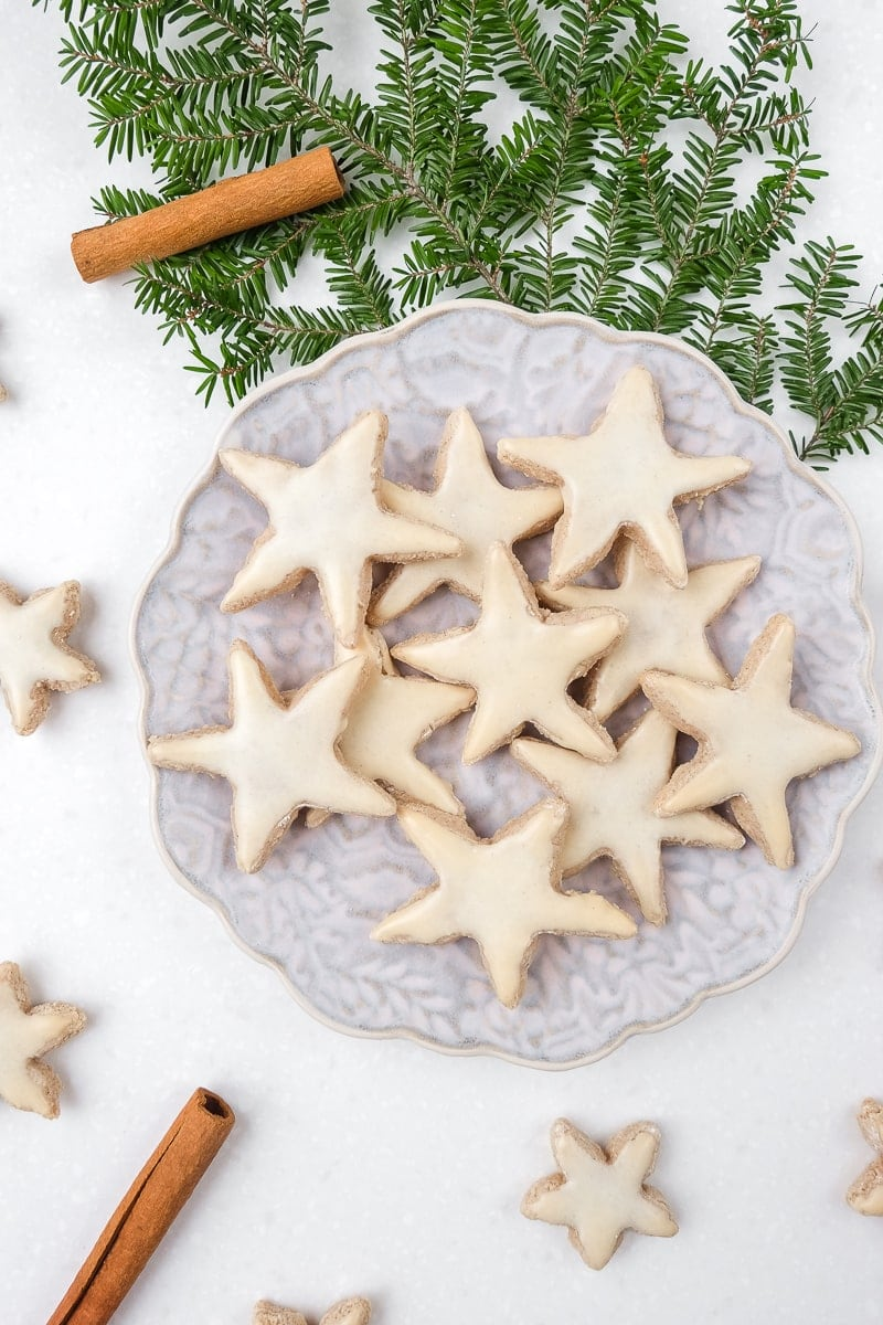 german cinnamon stars on a plate with white counter