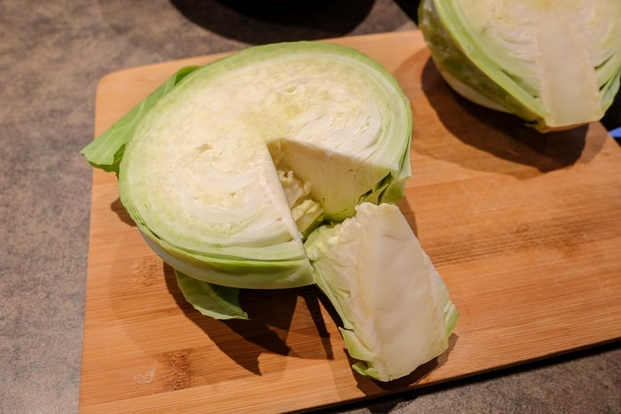 half of a green cabbage with core removed