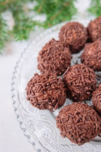 brown sprinkle german rum balls on clear plate