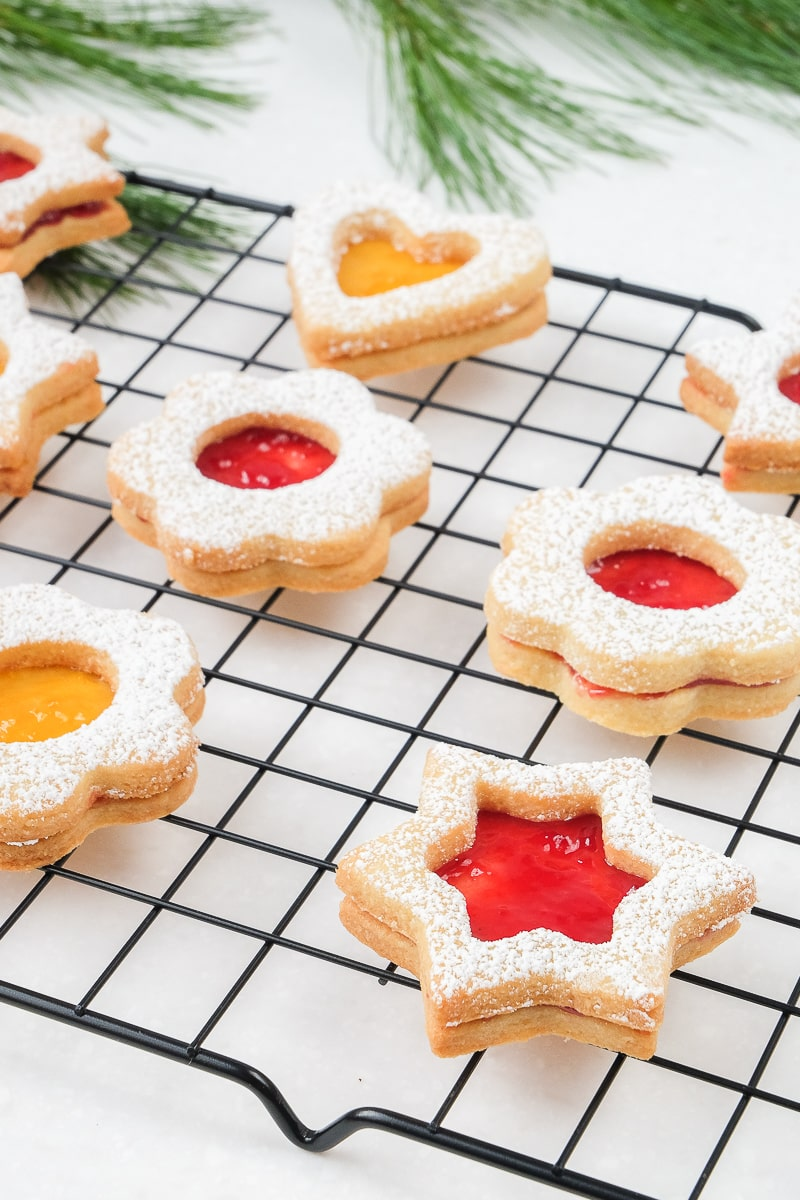 linzer cookies with jam on cookie cooling tray