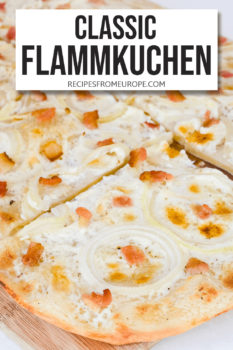 """Slices of Flammkuchen with creamy sauce sliced onion and bacon pieces on top on cutting board plus text overlay saying """"classic Flammkuchen"""""""