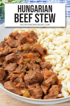 "cooked beef cubes in sauce in bowl with egg noodles and text overlay saying ""Hungarian beef stew"""