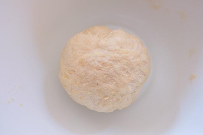 dough ball in white mixing bowl